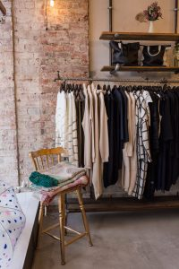 clothes hanging in fashion boutique