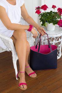 navy and pink handbag and fashion accessories