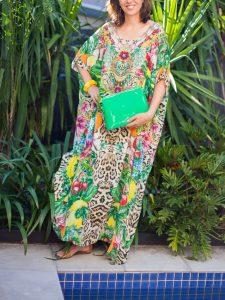 woman wearing colourful dress and green handbag