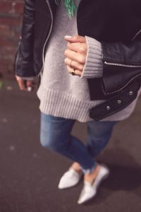 woman wearing jeans jumper and jacket