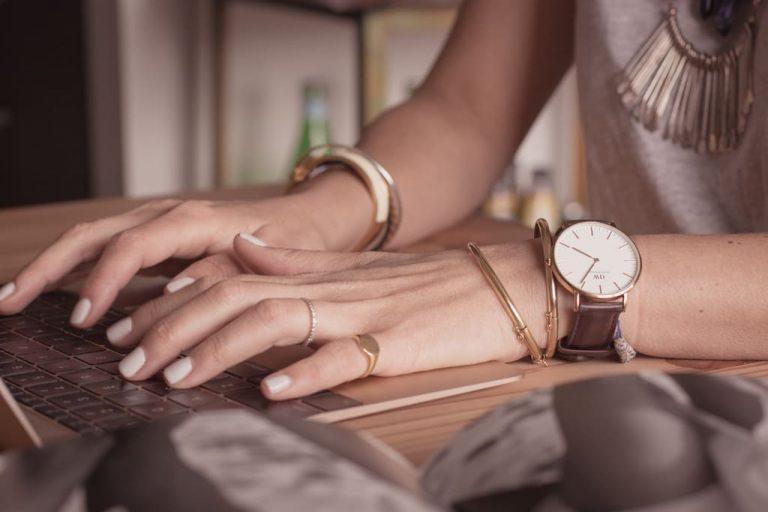 typing on keyboard wearing jewellery