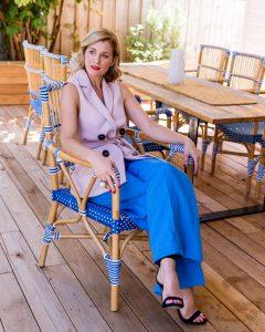 model sitting at cafe