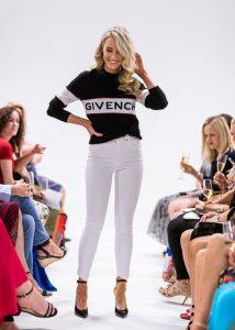 runway model wearing jeans jumper and heels