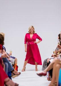 runway model wearing formal dress