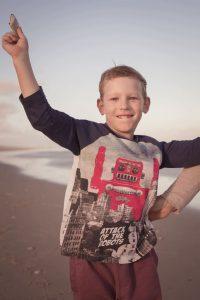 boy playing on the beach portrait