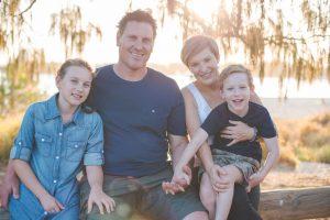 family sitting near the beach portrait