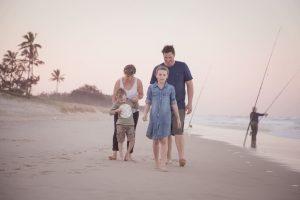 family walking on the beach portrait