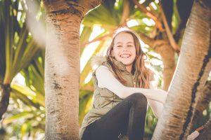 girl climbing a tree portrait