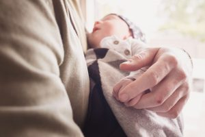 parent holding small baby