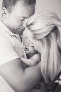parents holding their newborn baby