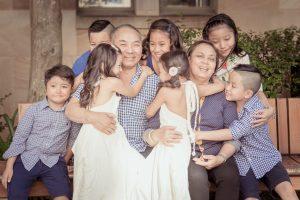 kids hugging their grandparents portrait
