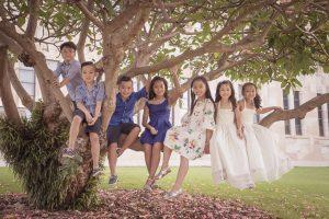 kids sitting in a tree portrait
