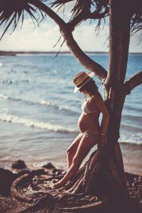 maternity portrait in bikini on the beach