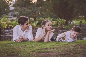siblings lying on the grass portrait